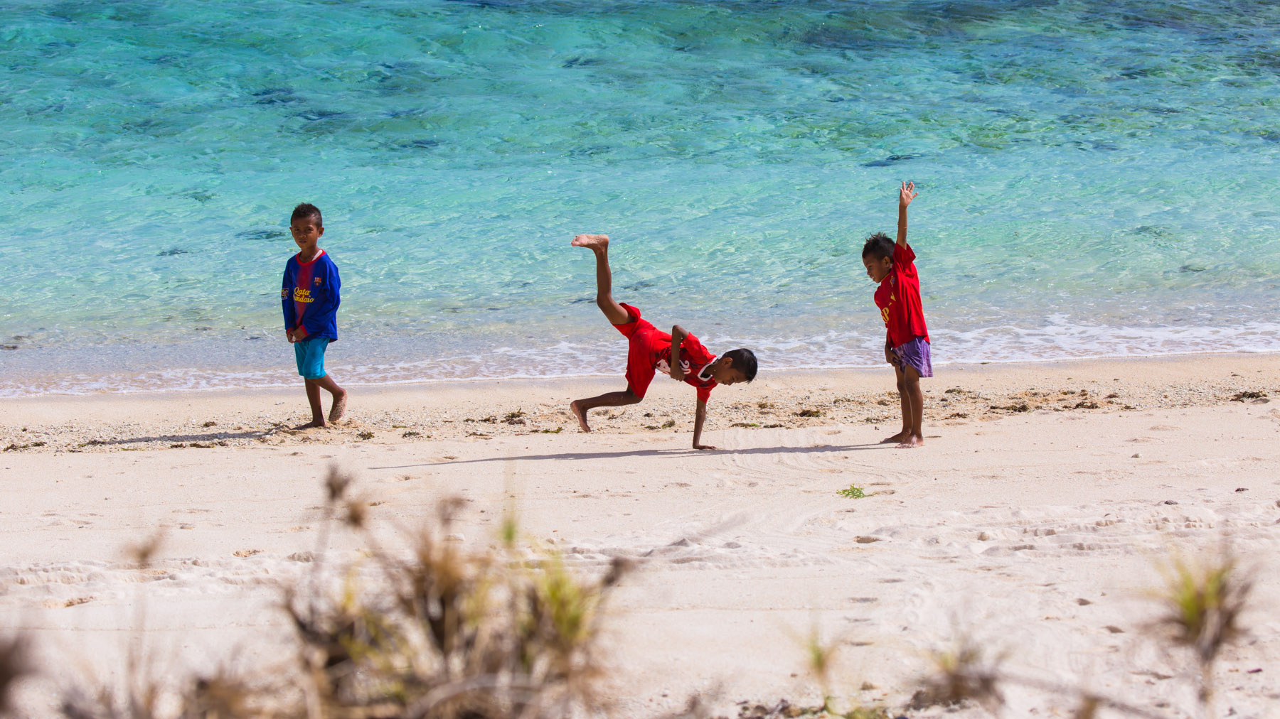 local children play on the beach