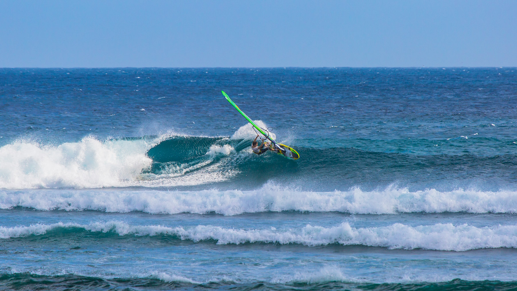 alastair mcleod windsurfing a fun reef break