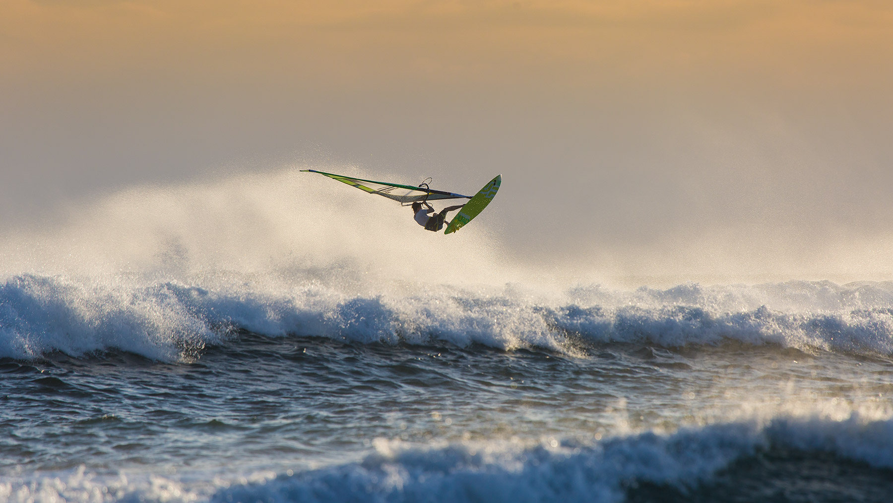 windsurfing aerial at sunset