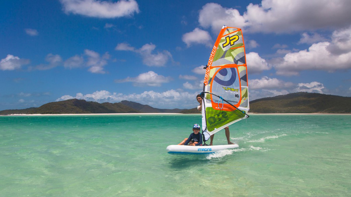 alastair mcleod windsurfing in the whitsundays on the le cochon noir v yacht